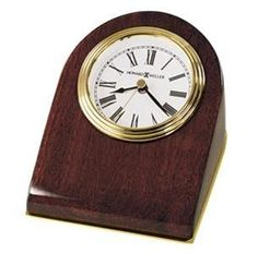 Howard Miller Bristol Table Top Clock. h1Howard Miller Bristol Table Top Clock_h1The Howard Miller Bristol Table Top Clock is a wedge-shaped desk clock with a brass finished base plate. The white face features a triple rim, brass tone bezel, glass crystal, and.. . See More Table Clocks at http://www.ourgreatshop.com/Table-Clocks-C1125.aspx