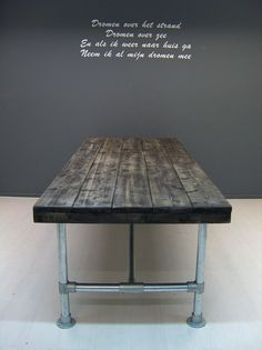 I love the industrial and rustic look of this table! Would love to recreate this some day