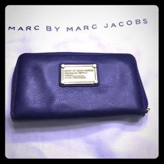 Purple Leather Marc by Marc Jacobs zip wallet  Authentic Purple leather zip around Marc by Marc Jacobs wallet. Exclusive as its discounted for store purchase. Perfect condition was used two months. Marc by Marc Jacobs Bags Wallets