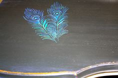 for all those peacock lovers(me), take a peacock stencil and paint these pretty feathers onto and table top, dresser top, or any other furniture that just needs a bit more color