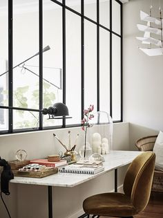 A design lover's dream, today's home has a lot of fabulous furniture and lighting pieces such as the Gubi  Beetle Chairs, and three differen...