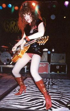 Poison Ivy of The Cramps on stage in all her sleazy pomp