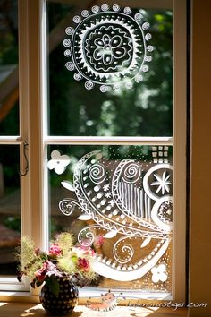Doodle on windows with a window marker. Done it with my daughter, hours of fun, we love it. They are easy to be wiped off without water, no mess at all.
