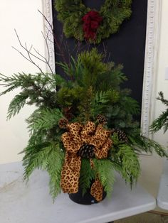 Christmas planter with cheetah flare Burlap Christmas Tree, Christmas Planters, Christmas Time, Christmas Wreaths, Merry Christmas, Holiday Decorations, Holiday Ideas, Holiday Gifts, How To Dress A Bed