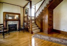 Living Room with Fireplace in Queen Anne Victorian House 114-Years-Old