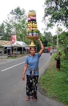 Balinese woman, Bali, Indonesia.My driver said that it was ok for me to take the photo and I asked her for permission before taking the photo. I was amazed with the things they carry on their heads!.people working with basket #people working with basket #people #Basket #wicker Basket #work #working #People at work #Business