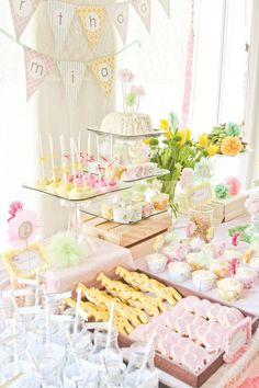DREAMY Princess Safari First Birthday Party: pink elephant & yellow giraffe cookies, pastel ribbon decorated highchair & thumbprint activity.
