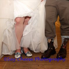 This bride and groom rocked their Star Wars Wedding style all the way down to their toes! The bride wears R2D2 flats and the groom wears Han Solo and Chewbacca socks with this dress shoes.