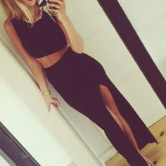 All black sleeveless crop top and maxi skirt with slit for a trendy and sexy club or party outfit