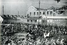 Battle of Shanghai - Japanese soldiers in front of a shelled Chinese school in Shanghai
