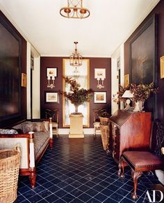 Early American antiques set the tone in the front entrance hall of the Long Island home of designers Thomas O'Brien and Dan Fink   archdigest.com