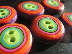 Polymer/modelling clay handmade buttons.  'Cute as a button' fridge magnet/photo frame idea...