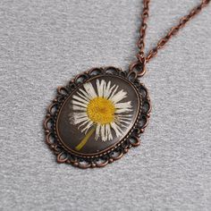 Real daisy resin necklace copper pendant pressed flower by PikLus, $12.00