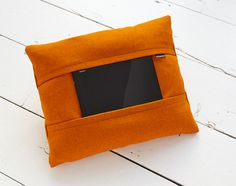 Now you can enjoy your tablet in ultimate comfort with Coqoon, the tablet pillow. Designed by dutch designer Koen Vorst, Coqoon is made to hold any 10-inch tablet, secured by strips of fabric, so that you can enjoy your tablet in any position.