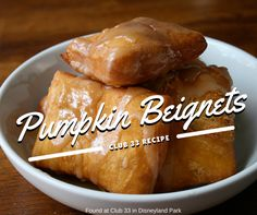 """Fall is almost here, which means it's time to plan your Disneyland park visits around the beignets at the Mint Julep Bar in New Orleans Square! We scoured the recipe archive for an """"upscale"""" version of our favorite fancy donuts – pumpkin beignets with a divine maple glaze, on the seasonal menu at the private Club 33 (open only to members, in New Orleans Square). Enjoy!"""
