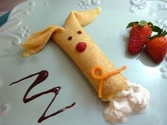 Easter Bunny Crepes Recipe | Ingredients:      2 eggs     1 egg yolk     ¾ cup skim milk     ½ cup flour     2 tsp butter, melted     ½ cup water     1 tsp sugar     dash of vanilla     Strawberries     Chocolate sauce     Whipped cream     Non-stick spray / 1 tsp butter