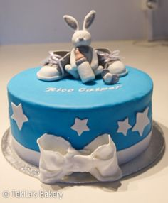Bunny and shoes in christening cake.