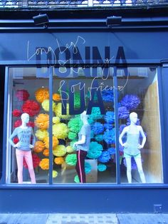 Love the big colourful suspended pom poms! Spring Window Display, Shop Window Displays, Store Displays, Retail Displays, Retail Windows, Store Windows, Shop Interior Design, Store Design, Luxury Sports Cars