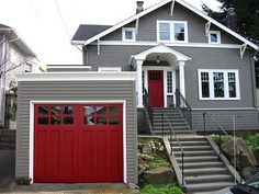 grey house, white trim, red doors