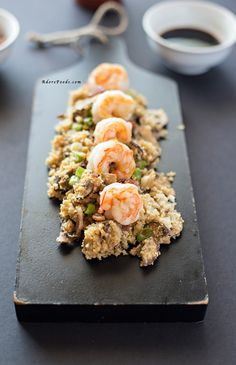 Easy cauliflower fried rice recipe with crispy bacon, prawns and shiitake mushrooms
