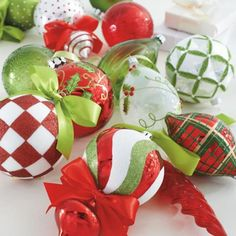 Trim your tree with designer flair, courtesy of the imaginative mix of designs in our Holly Jolly 20-piece Christmas Ornament Collection. Unique shapes; fanciful, hand-applied embellishments; and lime green, classic red, and white colorations give this festive array of ornaments undeniable character. 20-piece Christmas ornament collection in a variety of shapes, colors, and sizes A wonderful stand-alone display, or bring new color to your heirloom ornaments ...