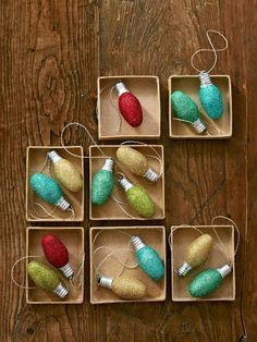 Just brush on glittering glue, roll the bulb in glitter, and let dry for 15 minutes. Then hot-glue a loop of metallic embroidery floss to the bulb's base.