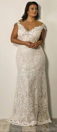 For a plus size bride who seeks for perfection and unique look. Curvy mermaid full lace bridal gown with off dhoulder sleeves. Adel. Studiol Levana.