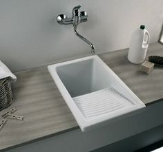 small laundry sink - ceramic w scrubbing section