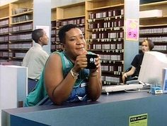 The Watermelon Woman (1996). Cheryl Dunye (playing herself) goes to the fictional CLIT Institute, an all-volunteer lesbian archives, to research a gay African-American actress from the 1930s. The archivist (Sarah Schulman) is careless with rare, primary materials. http://www.imdb.com/title/tt0118125/