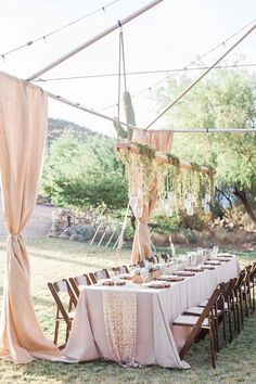 Rustic/Glam Outdoor DIY Wedding in the Arizona Desert ~ the couple hung mason jars filled with fairy lights from a plank of wood hanging above the head table