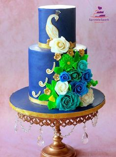 Peacock Wedding Cake in Royal Blue and sugar flowers
