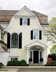 This is EXACTLY what I want the exterior of my house to look like, color wise. That is the very perfect shade of pale yellow, with black shutters. I've been talking about this house for years. New England Homes, New Homes, Gambrel Roof, Gambrel Barn, Black Shutters, Classic Shutters, Exterior Shutters, Yellow Houses, Exterior Paint Colors