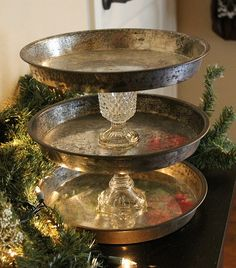 old pans and glass vases...what a good idea for a rustic centrepiece. Just fill those pans with fruit,nuts,delicious stuff,greenery.....ohh my imagination is running hehe