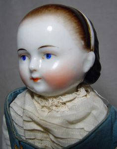 1860's China Head Doll. Alice in Wonderland head. Hairstyle with molded headband on a Motschmann type body.