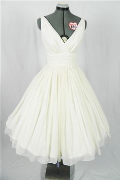Simple and elegant 50s style cocktail or wedding dress. Ivory chiffon overlay, flattering for all sizes