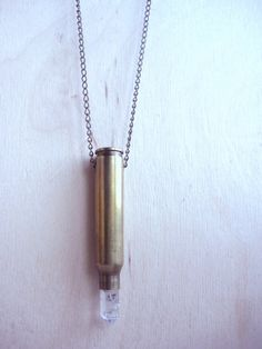 Made with a bullet casing and Herkimer Diamond crystal point. The crystal is secured with anti shock glue, strung on a nickle free chain. Necklace Measures: Ships in jewelry box and protective bubble envelope. Bullet Necklace, Arrow Necklace, Pendant Necklace, Bullet Casing, Herkimer Diamond, Bubble Envelopes, Jewelry Box, Necklaces, Chain