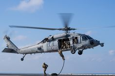 Sailors conduct a fast rope exercise from an Sea Hawk helicopter assigned to Helicopter Sea Combat Squadron (HSC) 14 on the flight deck of the aircraft carrier USS John C. Stennis (CVN in the Pacific Ocean. Us Navy Aircraft, Navy Aircraft Carrier, Navy Chief, Mass Communication, Military Helicopter, Flight Deck, United States Navy, Pacific Ocean, View Image