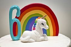 unicorn cake topper (combine rainbows with unicorns for party, click for ideas)