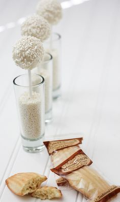 Cheesecake pops in small glass with white candy