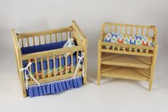 An two-piece nursery set in oak with blue marching giraffes pattern. Includes matching pillow, bumpers and matching blue skirt. Measurements: Crib - 4 x 2 x 1 Changing Table - 3 x Baby Doll Nursery, Giraffe Nursery, Miniature Crafts, Miniature Dolls, Miniature Furniture, Dollhouse Furniture, Diy Popsicle Stick Crafts, Diy Barbie Furniture, Barbie Doll House