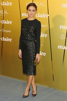 Olivia Palermo wears sequined Whistles top, a matching skirt and animal-patterned Stuart Weitzman heels for the Marie Claire Prix de la Moda Awards.
