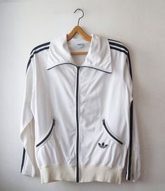 Items similar to adidas windbreaker,Adidas West Germany Jumper,adidas stripes black white Sweatshirt Vintage zippers Sleeves,man Sweatshirt Retro on Etsy Track Suits, Vintage Adidas, Mode Vintage, Mens Sweatshirts, Zippers, Adidas Jacket, 1970s, Jumper, Germany