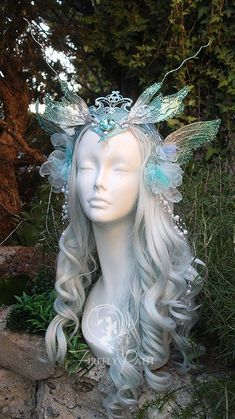 I was inspired to design a playful Water Sprite Headdress! A jewel encrusted crown connects two clusters of blue flowers and pearls at the sides of the head. Fabric and wire make double.Water Sprite Head Dress by Firefly-Path on DeviantArtDeviantArt: Wedding Checklist Detailed, Fantasias Halloween, Fairy Dress, Fairy Hair, Fairy Fancy Dress, Fantasy Dress, Fantasy Jewelry, Tiaras And Crowns, Handfasting