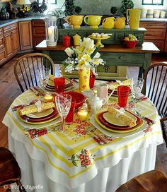 LOVE this table, especially that vintage tablecloth and the rain boot holding the flowers!