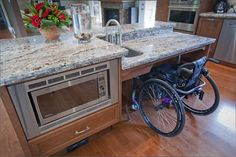 Accessible island with built-in microwave and multiple counter heights. Lovely addition to any kitchen!