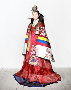 Woman wearing a Hwarot, a  traditional Korean robe worn during the Goryeo and Joseon Dynasties by royal women for ceremonial occasions or by commoners for weddings.