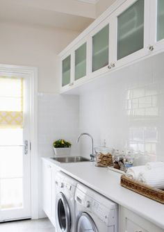 Walk through mudroom and laundry room. All white laundry room with sink, white subway tiles, and glass upper cabinets. Beautifully styled with tray of soaps and hand towels. Mudroom Laundry Room, Laundry Room Cabinets, Laundry In Bathroom, Laundry Area, Laundry Decor, Laundry Room Inspiration, Small Laundry, Small Sink, Laundry Room Design