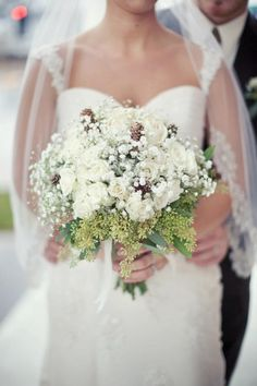 Winter bridal bouquet - english roses, baby's breath, pine cones, seeded eucalyptus