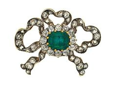 A late 19th century emerald and diamond bow brooch   Designed as a diamond-set ribbon bow with central rectangular-shaped emerald and old-cut diamond cluster, circa 1870, converted, 3.7 cm wide, with French assay mark on pin