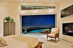 The master bedroom boasts a fireplace and breathtaking views. - Courtesy of Pacific Sotheby's International Realty